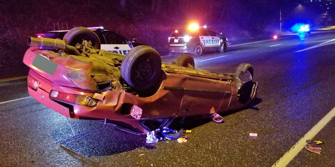 Armed, convicted felon flips car after being chased through White Center