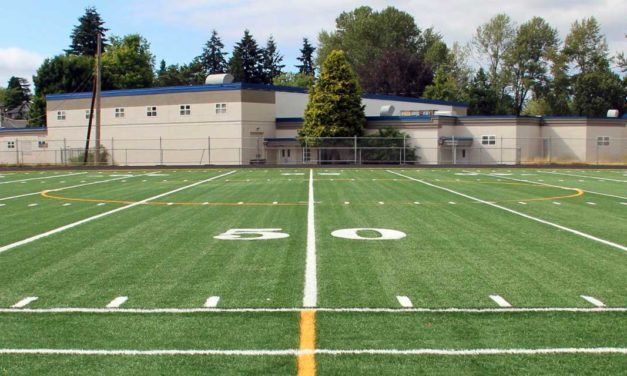 PHOTOS: Crews install new synthetic turf at Evergreen High School field